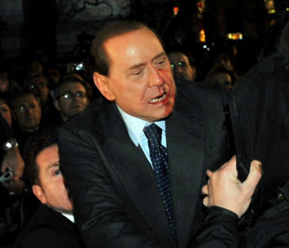Silvio Berlusconi spends 'settled night' after attack