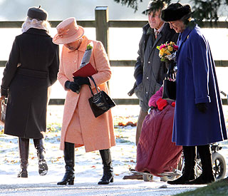 Stylish Queen braves winter chill to attend church