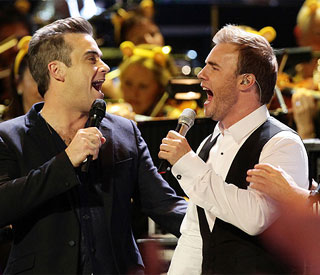 Friends reunited: Robbie joins Take That for Haiti song