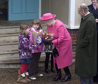 The Queen turns 'dinner lady' during church visit