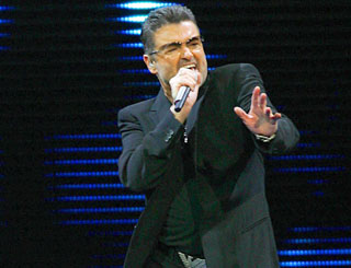 Police called after George Michael leaves house open