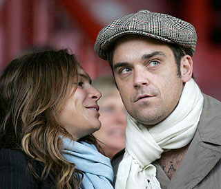 Robbie Williams delays wedding to Ayda Field