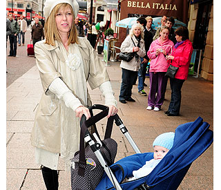 Beaming Kate Garraway takes baby Billy to premiere