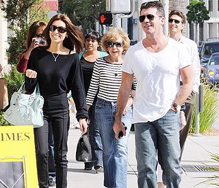 Cosy family outing for Simon Cowell and Mezghan