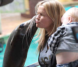 Friendly kiss for Kerry Katona on family day at zoo