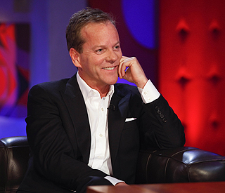 No sign of a hangover for partying Kiefer Sutherland