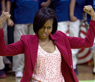 Let's get physical: Mrs Obama flexes super-toned arms