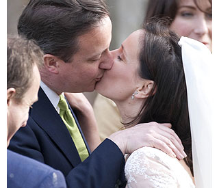Kiss for the bride from brother David Cameron