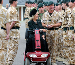 Camilla honours the troops on stylish red scooter