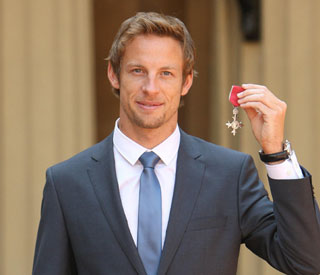 Jenson Button receives MBE from Queen Elizabeth