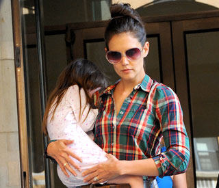 A sleepy Suri Cruise and mum Katie return to New York