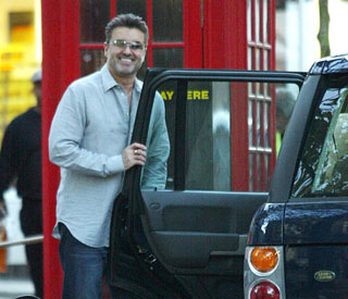 George Michael arrested after crashing into shop