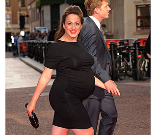 Expectant Natalie Cassidy flaunts bump in tight LBD