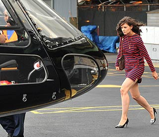 Jet-setting Katie arrives in style for NY premiere