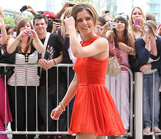 A smiling Cheryl Cole steps out after malaria battle