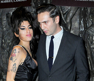 Amy Winehouse and boyfriend Reg Traviss resolve row