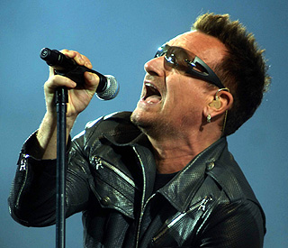 Bono beats back injury and returns to the stage