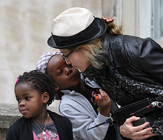 A kiss from mum: Madonna shows love on set of film
