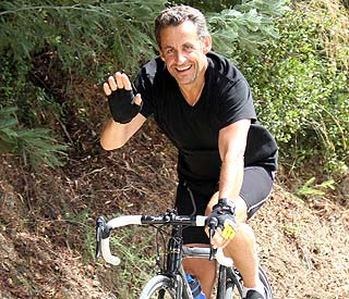Nicolas Sarkozy enjoys the ride during Ri