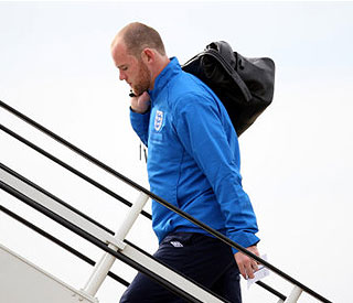 Sponsors back Wayne Rooney as he flies out of UK