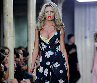 Pregnant Abbey Clancy flaunts curves on the catwalk