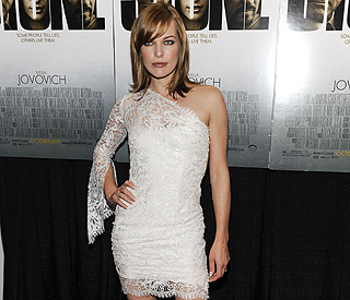 Milla Jovovich is a vision in white at premiere