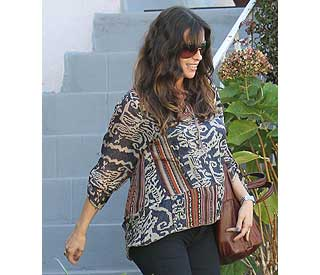 Radiant Alanis Morisette proudly displays baby bump