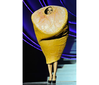 Is Eva Longoria Gaga? She hams it up with meat outfit
