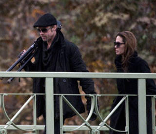 Handy Brad Pitt mucks in on Angelina's film set