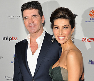 Still on: Simon Cowell and fiancée's show of unity
