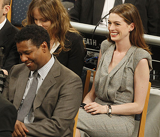 Anne and Denzel get the giggles at Nobel ceremony