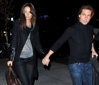 Tom Cruise and Katie Holmes paint the town red