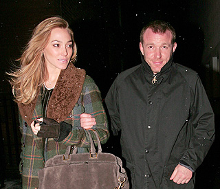 Guy Ritchie's model girlfriend Jacqui moves in