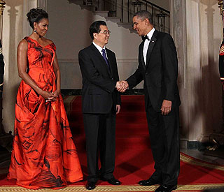 Lady in red: Michelle Obama wows at state dinner