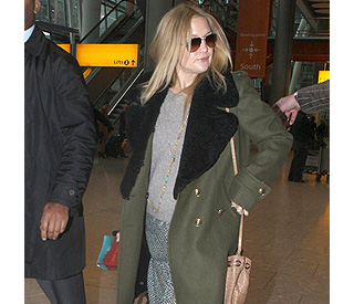 Baby bump watch: Kate Hudson arrives in London