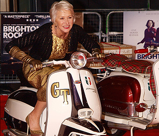 Dame Helen Mirren looks wheely hot as she revs up