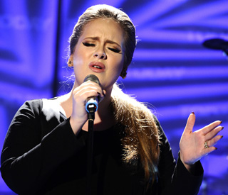 Adele breaks chart history with record double