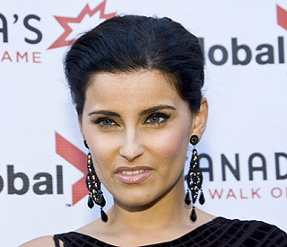 Nelly Furtado gives Gaddafi gig money to charity