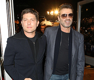 George Michael denies splitting with Kenny Goss