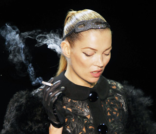 Kate Moss 'lights up' on Paris runways