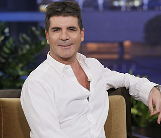 Simon Cowell hits back at Elton criticism
