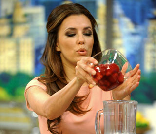 Pretty in pink Eva Longoria promotes her new cookbook