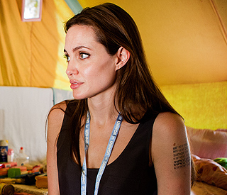 Angelina Jolie's new tattoo sparks adoption speculation
