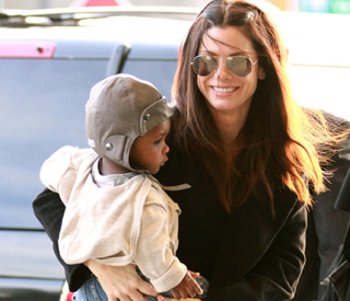Sandra Bullock takes little Louis home to Texas