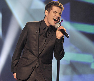 'X Factor's Joe McElderry dropped by record label