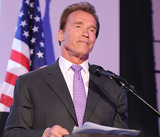 Arnold Schwarzenegger: wife and I 'love each other'