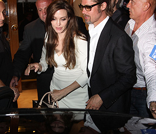 Chivalrous Brad puts Angelina first on night out