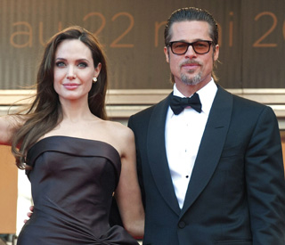 Angelina supports Brad at new film premiere
