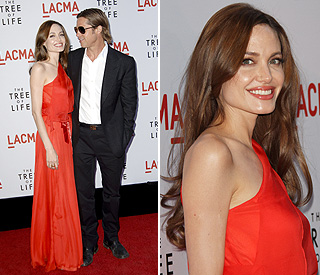 Scarlet beauty Angelina turns up the glamour for Brad