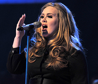 Adele postpones US tour dates